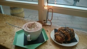 A candlelit cuppa joe and croissant with chocolate drizzle at Nelles café on Overgade. Photo by Mary Farabee.